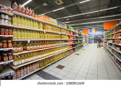 ROME, ITALY. March 08, 2015: Series of bottles of sunflower oil, olive, peanut oil and other types on the shelves inside a supermarket in the city of Viterbo in Italy.