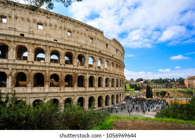 Rome, Italy - March 10 2018: Large group of tourists are spending time near the Colosseum at sunny day