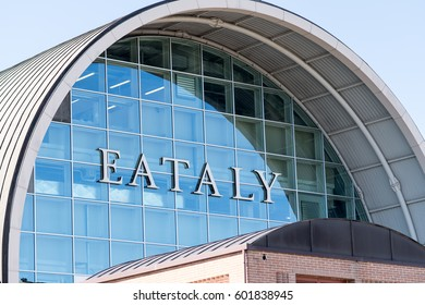 Rome, Italy - March 11, 2017: Arch-shaped exterior of Eataly building. Eataly is the upscale food emporium chain; Rome branch opened in 2012 in abandoned air terminal near Ostiense train station