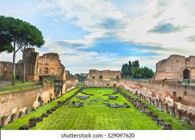 ROME, ITALY - MARCH 13, 2016:Picturesque aerial panoramic view on the Rooms of the Domus Augustana ( House of Augustus ,Domus Augusti or Augustea) in the evening ,at sunset. Palatine Hill. Roman Forum