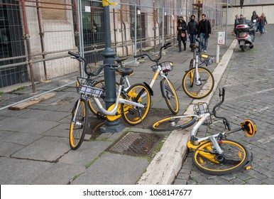 ROME, ITALY - MARCH 18, 2018: oBike bike sharing bicycles on sidewalk in Rome, Italy