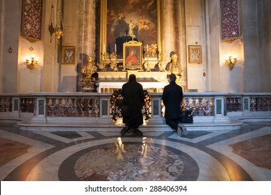 ROME, ITALY - MARCH, 2015: Believers praying on a church in Rome, Italy.