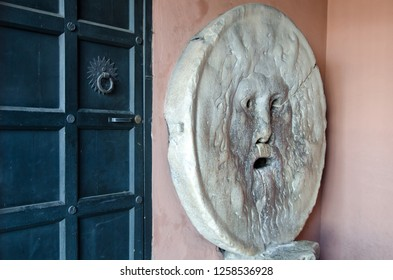 Rome, Italy - March, 2018: The Mouth of Truth (Italian: Bocca della Verita) attracts tourists who audaciously stick their hand in the mouth.