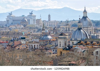 Rome, Italy - March, 2018: Panorama of Rome (and view at Vittorio Emanuele II Monument) from Angel Castle (Castel Sant'Angelo).
