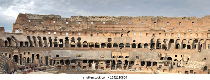 Rome, Italy - March 20th, 2019: Interior of the Roman Colosseum (Coliseum, Colosseo), also known as the Flavian Amphitheatre. Famous world landmark. Scenic urban landscape. - Image