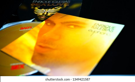 Rome, Italy - March 23, 2019: CDs and artwork of spanish singer, songwriter, actor and record producer ENRIQUE IGLESIAS. which has sold over 170 million records (albums and combined singles) worldwide