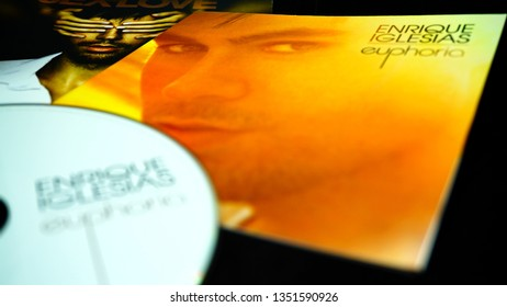 Rome, Italy - March 23, 2019: CDs and artwork of spanish singer, songwriter, actor and record producer ENRIQUE IGLESIAS. He is widely regarded as the King of Latin Pop