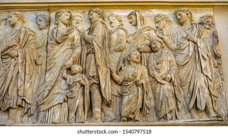 ROME, ITALY - MARCH 24, 2019 Imperial Family Statue Ara Pacis Altar of Augustus Peace Rome Italy. Monument to Emperor Augustus Caesar built 9 BC
