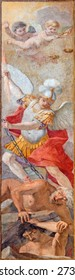 ROME, ITALY - MARCH 26, 2015: The fresco of St Michael Defeating Satan  by Giacinto Gimignani (1606 - 1681) in church Chiesa di Santa Maria ai Monti.