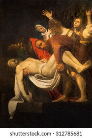 ROME, ITALY - MARCH 26, 2015: The Copy of Deposition of the cross by M. Koch (1797) in church Santa Maria in Vallicella. The original by Caravaggio (1571 - 1610) is in the Vaticans museums.