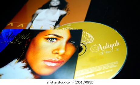 Rome, Italy - March 26, 2019: CDs and artwork of the American singer, actress, and model Aaliyah. Billboard lists her as the tenth most successful female R&B artist of the past 25 years