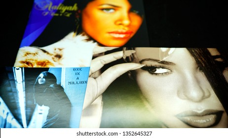 Rome, Italy - March 26, 2019: CDs and artwork of the American singer, actress, and model Aaliyah. were killed in a plane crash in the Bahamas after filming a music video