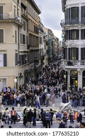 Rome, Italy - March 29, 2006 -   Crowd on the elegant place of Spain, Piazza di Spagna, with its typical houses and  fountain in the middle of the square,Rome, Italy. A place where tourists meet