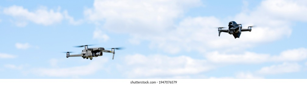 Rome, Italy, March 31, 2021. Two Dji drones are flying nearby during a sunny day. DJI FPV is a groundbreaking ready-to-fly FPV drone that lets users feel the thrill of immersive flight.