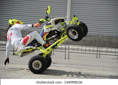 Rome, Italy - March 7th, 2019: a Professional dirt quad rider doing wheely in the streets of Rome