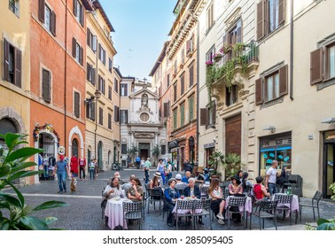 ROME, ITALY - MAY 05, 2015 : Unidentified people at street restaurant in Rome, Italy.