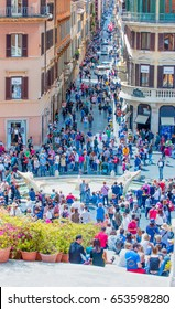 ROME, ITALY - MAY 05, 2017: Tourists walking on the Old Town street near Spanish Steps (Piazza di Spagna) - Rome, Italy