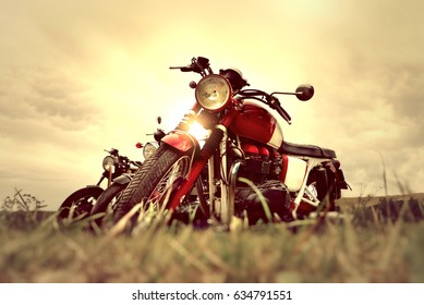ROME, ITALY - May 06, 2017: Light filter effect - Triumph vintage motorbikes parking on the grass during Gustock festival, meeting for vintage cars and motorcycles collectors.