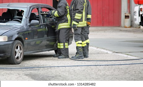 Rome, Italy - May 10, 2018: Italian firemen use the shears to free the injured on the car after the road accident