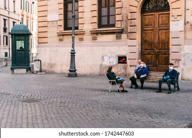 Rome, Italy - May 10 2020: Locals relaxing in an empty Jewish Quarter with no tourists due to COVID-19 lockdown