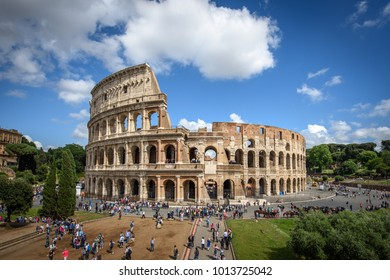 Rome, Italy - May 12, 2016: Colosseum during the day with blue sky in Rome, Italy. Roman Colosseum is a landmark and one of the best known monuments Italy and a UNESCO World Heritage Site. (0261)