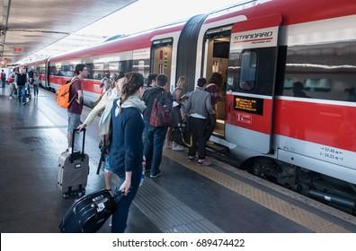 ROME, ITALY - MAY 2017: Travelers board FrecciaRosa train to Salerno from Roma Termini train station. FrecciaRosa, once known as Eurostar Italia, are high speed trains, premier service of TenItalia