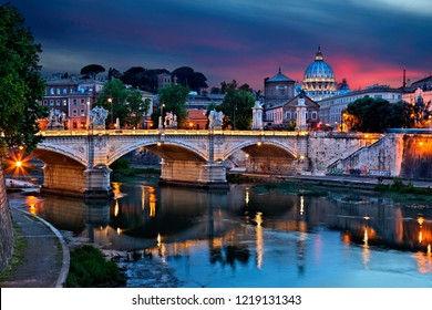 ROME, ITALY - May 22, 2017 . Ponte Vittorio Emanuele II and Tiber river, as seen from Ponte Sant'Angelo. In the background the dome of St Peter's Basilica.