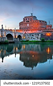 ROME, ITALY - May 22, 2017.  Castel Sant'Angelo and Ponte Sant'Angelo reflected on Tiber river.