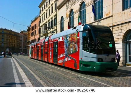 ROME, ITALY - MAY 22 : Tram picks up the passengers on the strreet of Rome on May 22, 2011. Public Transportion includes metro, buses and trams.