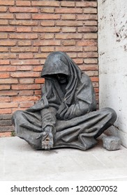 "ROME, ITALY  - MAY 24, 2011: ""Homeless Jesus"" ,""Begging Christ"" statue in Rome. Jesus as begger sitting on the ground with his hand outstretched, asking for alms"