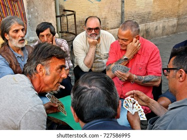 ROME, ITALY - May 26, 2017.  Card game between friends and neighbours at Piazza di San Calisto, Trastevere, Rome, Italy