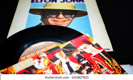 Rome, Italy - May 27, 2019: two 45s of British singer-songwriter, composer and musician Elton John. During his long career he has officially sold over 400 million records