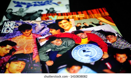 Rome, Italy - May 27, 2019: CD covers of 90s boy bands. The term starts to be used from the mid-eighties, when New Kids On The Block is formed in the United States