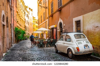Rome, Italy - May 28, 2017: Cozy street in Trastevere with vintage car parked.
