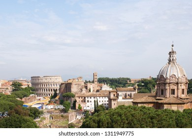 Rome, Italy, May 28, 2018: View from the Monument to Vittorio Emanuele II to the Colosseum and church Chiesa dei Santi Luca e Martina in Rome