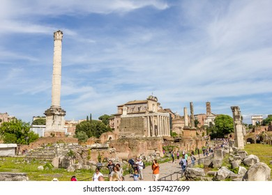 ROME, ITALY - MAY 3, 2015 : People walking in the Roman Forum. The place contains ancient government buildings at the center of Rome.