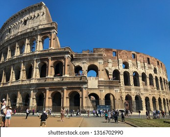 Rome, Italy - May 30, 2018: Colosseum. The central entrance to the coliseum. Tourists walk near the Colosseum