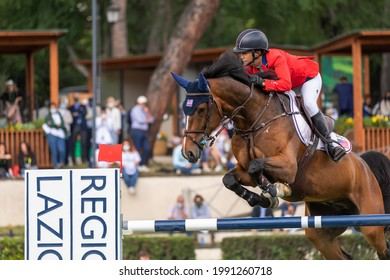 Rome, Italy - May 30, 2021: Laura Kraut (USA) onward Baloutinue during the Rolex Grand Prix Rome at 88th CSIO 5° Master D'Inzeo at Piazza di Siena.