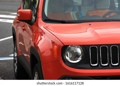 Rome, Italy: May 31, 2019 - Left side of the orange vehicle Jeep Renegade on Rome streets.