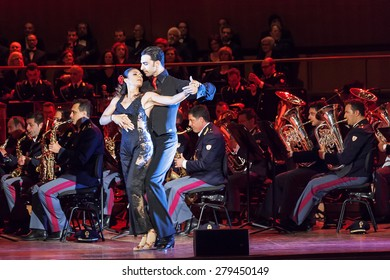 Rome, Italy - May 6, 2015: The dancers Giusy Versace and Raimondo Todaro, dance accompanied by the music of the Band of the State Police.