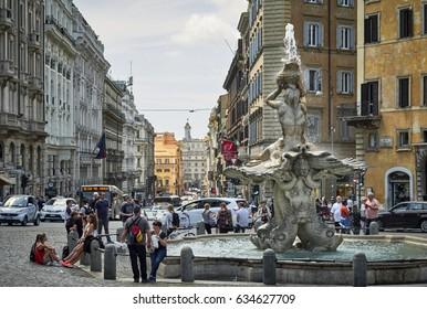 ROME, ITALY - MAY 6, 2017: Barberini Square full of tourists around its beautiful Bernini's famous fountain