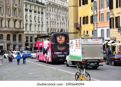 Rome, Italy - May 9, 2018: a sightseeing bus with an advertisement for The Handmaid's tale drives tourists through the streets of the eternal city.