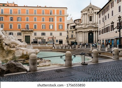 Rome, Italy - May 9, 2020: an almost empty square in front of the Trevi Fountain during the very first days of phase 2 of COVID19 lockdown. Gone are the tourists, Rome is for the residents now.