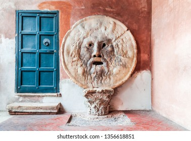 Rome, Italy. The Mouth of Truth (La Bocca della Verita) carved from Pavonazzo marble, in the portico of the church of Santa Maria in Cosmedin.