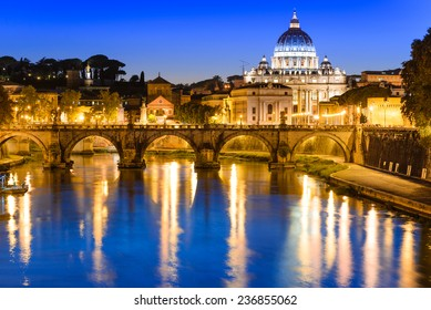 Rome, Italy. Night image of Vatican, dome of San Pietro and Sant Angelo Bridge, over Tiber river.