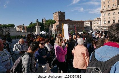 ROME, ITALY - NOVEMBER 10 2018:  demonstration in Piazza Venezia under the Trajan Column, activists protest against the Pillon DDL