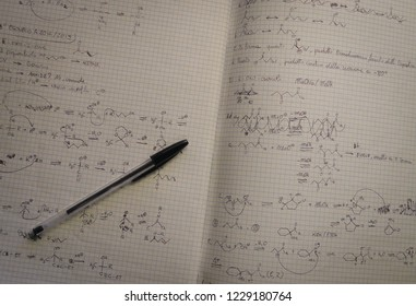 Rome, Italy - November 10 2018: College organic chemistry lecture notes on various reactions, with a simple black pen on a white squared paper exercise book.   All the readable phrases are in italian.