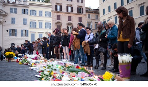 ROME, ITALY - NOVEMBER 14, 2015: Flowers and lit candles in front of the French Embassy in Piazza Farnese in Rome after the terrorist attacks in Paris on 13 November.