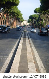 Rome / Italy - November 16 2018: Distant phot of road leading to   masterpiece Arch of Constantine next to iconic Colosseum