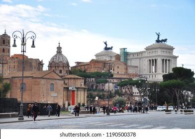 Rome / ITALY  - NOVEMBER 16,2017: Rome city scape from Via Dei Fori Imperiali including Palazzo Venezia, Piazza Venezia and Santi Luca e Martina.